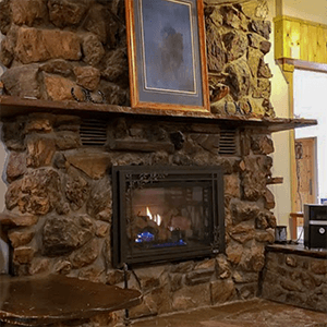 Cowboy Inn Fireplace with painting